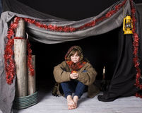 Child in poverty. A young child in a shelter at xmas royalty free stock image