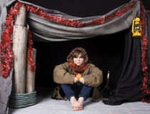 Child in poverty. A young child in a shelter at xmas stock image