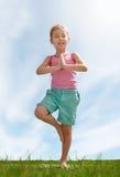 Child practicing yoga Royalty Free Stock Photos