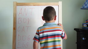 Child practising writing Royalty Free Stock Images