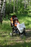 Child in pram in forest Royalty Free Stock Photos