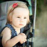 Child in pram outdoors Royalty Free Stock Images