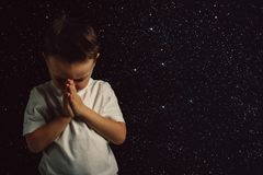 A child pray to god flush hands. Child pray to god flush hands royalty free stock photography