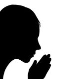 Child praying. Silhouette of child praying, over white background Royalty Free Stock Photos