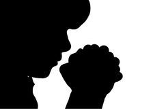 Child Praying. This silhouette of a boy praying will work virtually anywhere Royalty Free Stock Photography