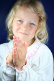 Child praying. stock photos