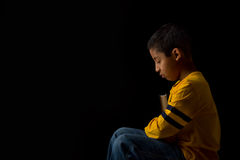 Child Praying with Bible Stock Images