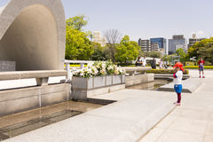 Child praying in the Hiroshima Peace Memorial Park Royalty Free Stock Photos
