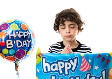 Child Praying during his birthday party. Thanking God for another year of life. Hispanic child praying before his birthday party. He wants it to be a success Royalty Free Stock Photo