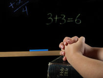 Child praying in school Royalty Free Stock Images