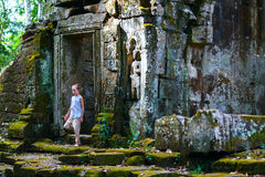 Child in Preah Khan temple Stock Photo