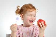 Child preferring healtthy food and no sweets Stock Images