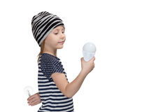 Child prefers to energy-saving lamp Royalty Free Stock Photo