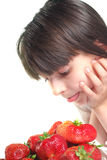 Child prepare eat of strawberries Stock Photography