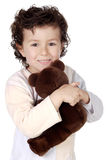 Child prepared to slep. Adorable child prepared to sleep with its bear a over white background Royalty Free Stock Images