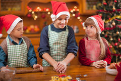 Child preparing cookie for family dinner on Xmas eve Royalty Free Stock Photo