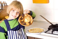 CHILD PREPARING FOOD Royalty Free Stock Image