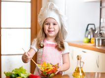 Child preparing healthy food at kitchen Stock Photo