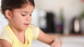 A child preparing a pastry stock video