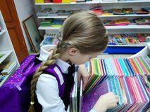 Child is preparing for school. The child chooses the store school supplies. Preparation for school royalty free stock photo