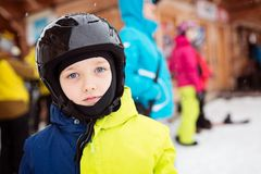 Child preparing for skiing. Royalty Free Stock Photography