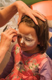 Child preschooler with face painting. Make up. Stock Photos