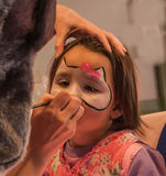 Child preschooler with face painting. Make up. Stock Photo