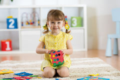 Free Child Preschooler Girl Plays Logical Toy Learning Shapes And Colors At Home Or Nursery Stock Photo - 92394850