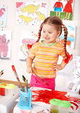 Child preschooler in orange draw picture. Child preschooler in orange draw picture in play room stock photos