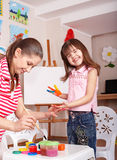 Child preschooler with paint hand. Stock Photos