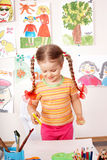 Child preschooler painting in classroom. Stock Photo
