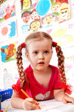 Child preschooler with pencil in play room. Royalty Free Stock Images