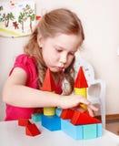 Child preschooler play wood block . Royalty Free Stock Photos