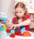 Child preschooler play wood block. Stock Image