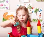 Child preschooler play wood block. Royalty Free Stock Photos