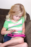Child or preschooler using a tablet Royalty Free Stock Image