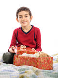 Child with present in Christmas eve Stock Photos