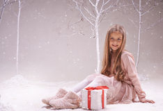 Child with present Stock Images