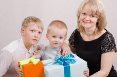 Child presented with gifts. Five children give gifts mother and brother royalty free stock photography