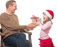 Child presents gift to father Stock Photos