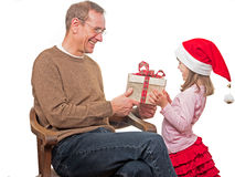 Child presents gift to father Royalty Free Stock Images
