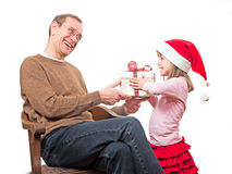 Child presents gift to father Stock Photography