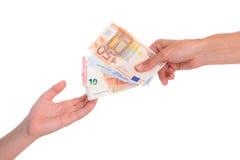 Child preserve pocket money Stock Photo