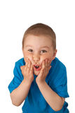 Child pressed his hands to the cheeks. On white stock images