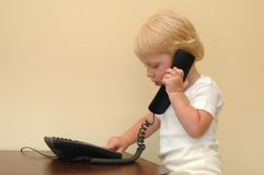 Child presses telephone buttons Stock Photos