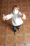 Child with pretective mask and thumbs up Royalty Free Stock Photography