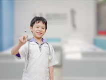 Child pretend to be doctor Royalty Free Stock Image