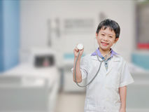 Child pretend to be doctor Stock Images