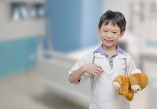 Child pretend to be doctor Stock Photos