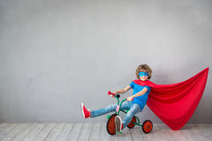 Child pretend to be superhero. Kid playing at home. Success, creative and imagination concept Stock Photography